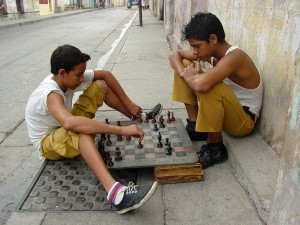 Boys playing chess on street in Santiago de Cuba (2003) Photo by Adam Jones